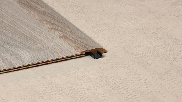 Reducer strips for laminate flooring