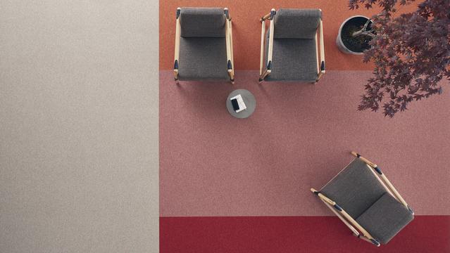 Rött, rosa och gråbeige i en kontorslokal - Desso Tarkett